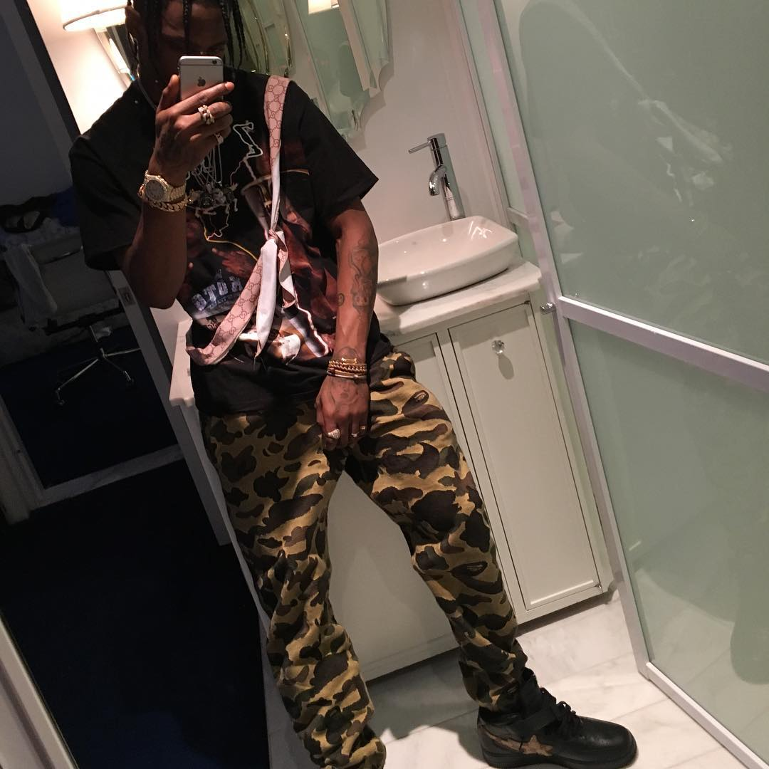 Travis Scott wearing the 'Camo' A Bathing Ape Bapesta Mid