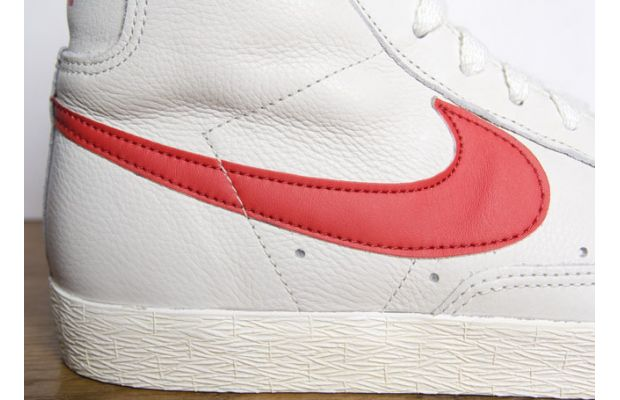 white and red nike blazers