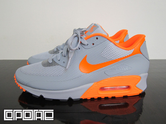 Look for the Stealth / Total Orange Nike Air Max 90 Hyperfuse this season at a select Nike Sportswear retailer near you.