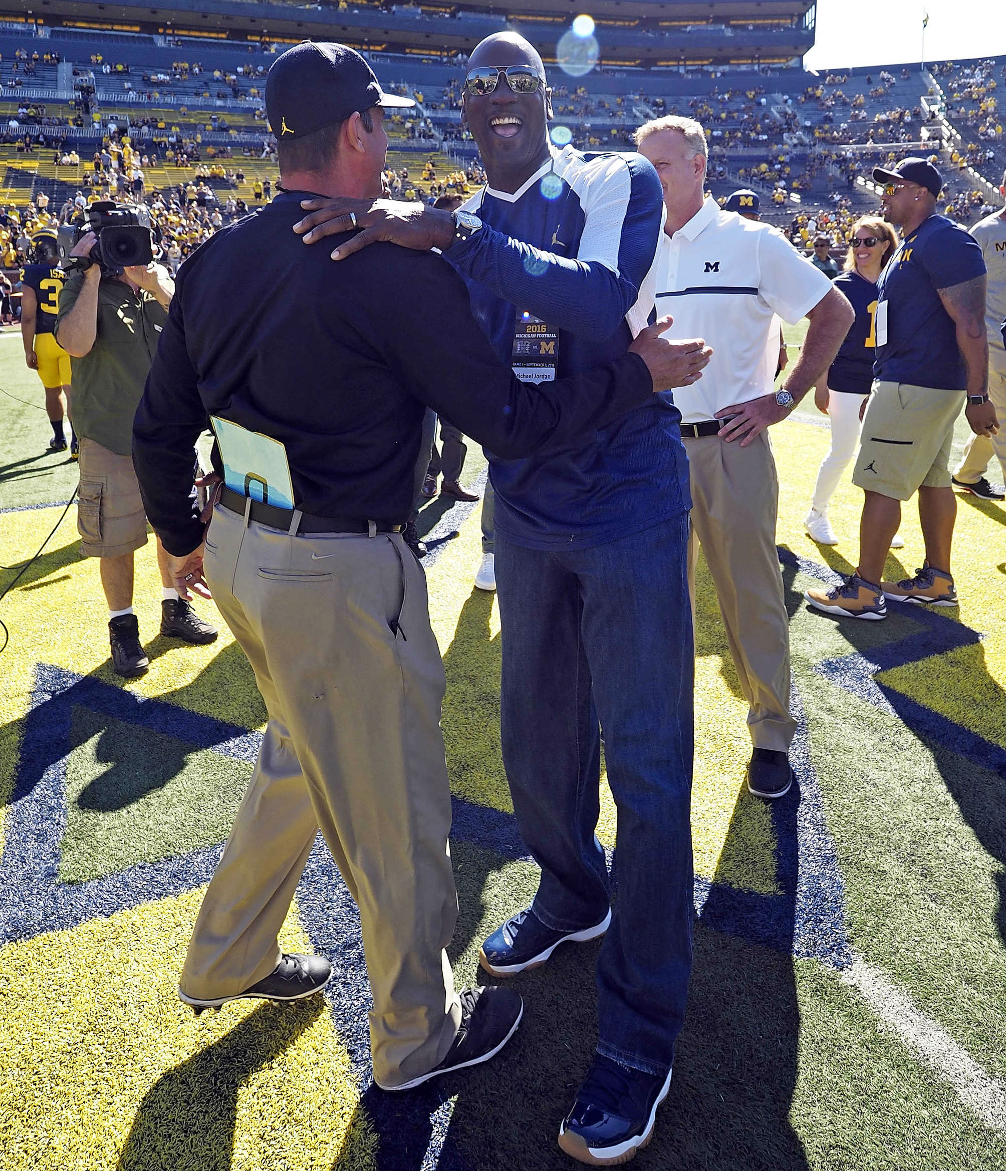 Michael Jordan Wearing the Navy/Gum Air Jordan 11 Low at the Michigan Game