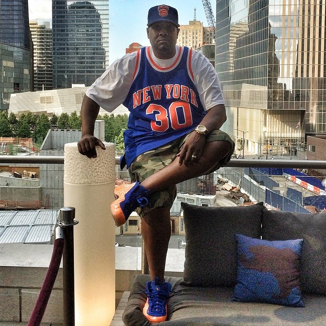 DJ Clark Kent wearing Nike Air Foamposite One Knicks