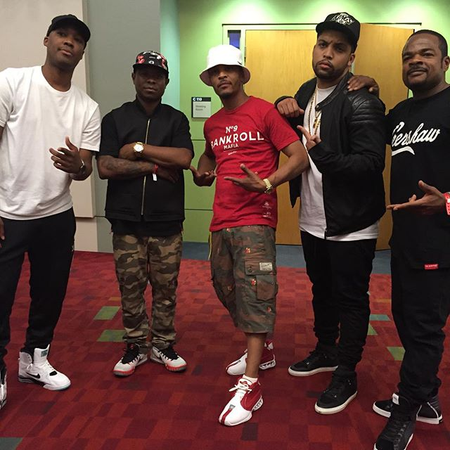 T.I. wearing the White/Red Nike Air Zoom Vick 2