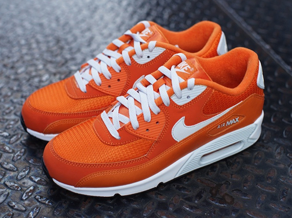 00d2c1e19402 The  Solar Orange  Nike Air Max 90 is now available at select spots such as  Oneness.