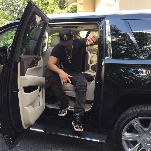 DJ Envy wearing the 'Croc' Air Jordan 11 Low IE