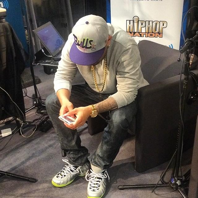 40a6c868a12 DJ Envy wearing Nike Air Foamposite One Silver Camo