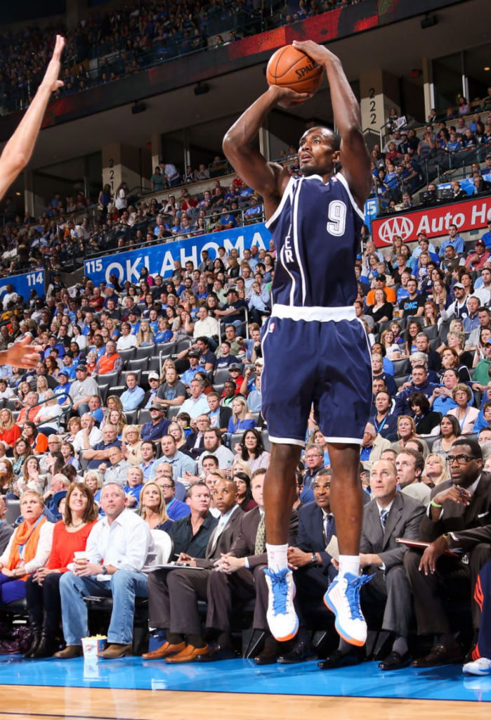 Serge Ibaka wearing Oklahoma City Thunder Alternate and adidas adizero Ghost 2