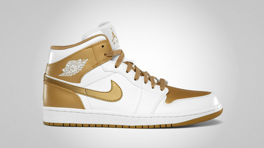 white nike air jordans with a gold jordan