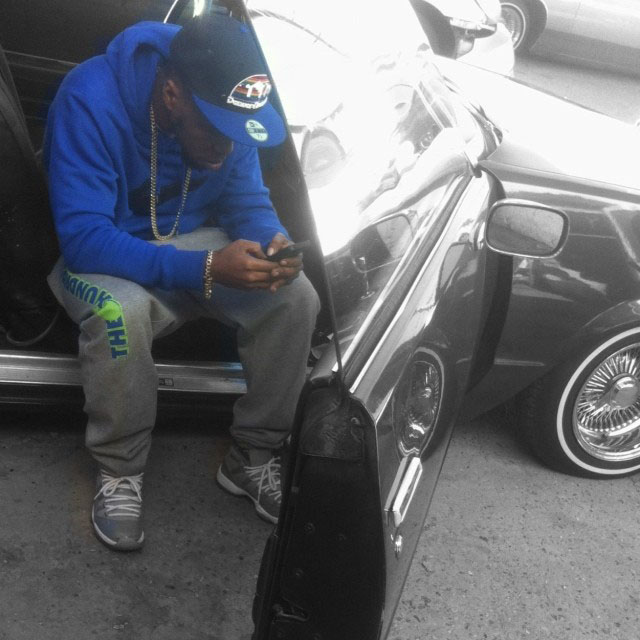 Currensy wearing Air Jordan 11 Cool Grey