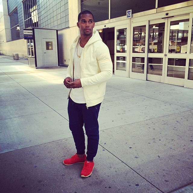 Victor Cruz wearing Ronnie Fieg x Clarks Kildare Poppy Red