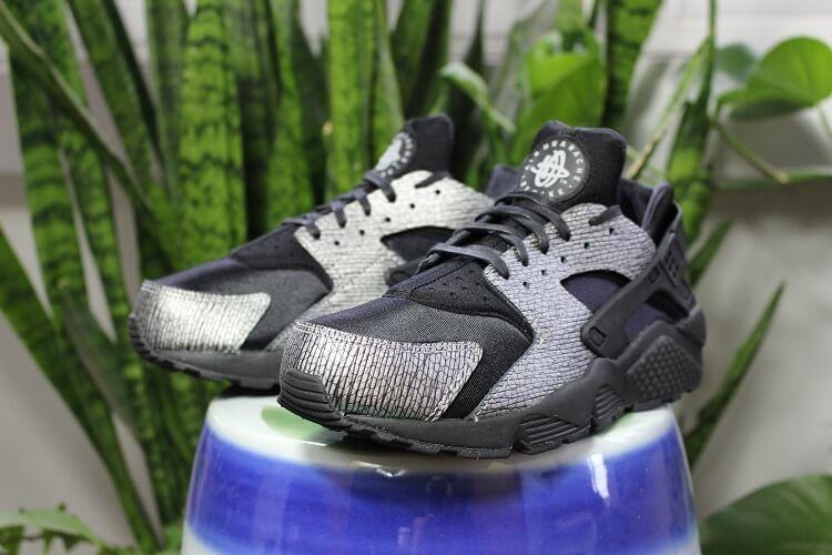 cheaper 2dc07 f28e8  Triple Black  Nike Air Huaraches Get a Shiny Upgrade