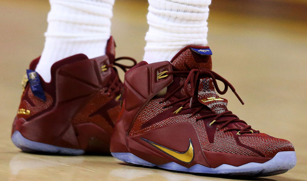 LeBron James wearing a Wine/Gold-Navy Nike LeBron XII 12 PE