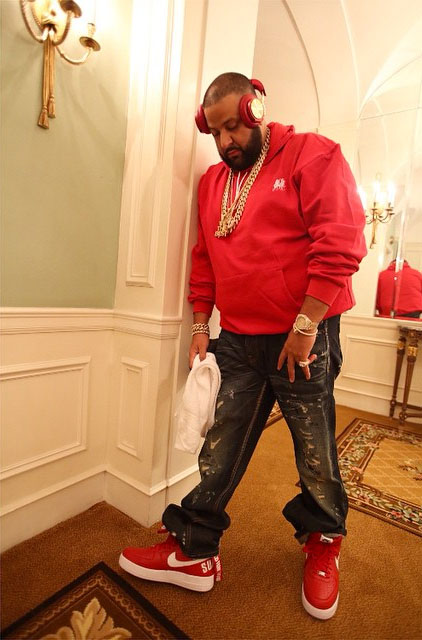DJ Khaled wearing Supreme x Nike Air Force 1 High Red