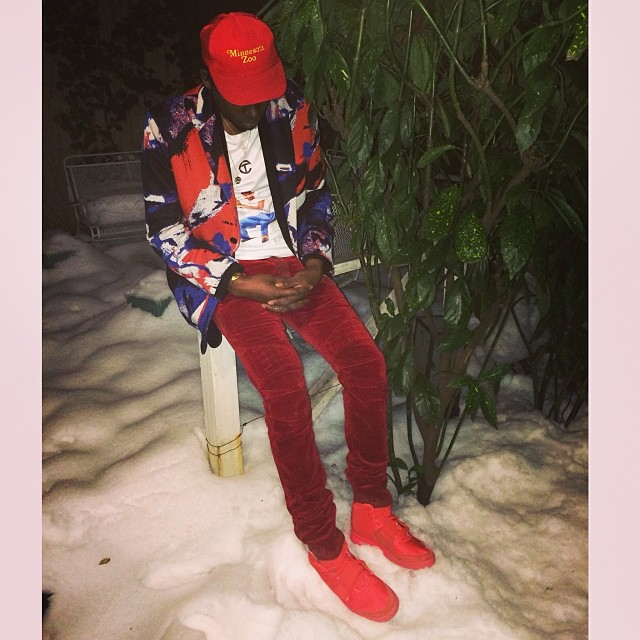 Theophilus London wearing Nike Air Yeezy 2 Red October