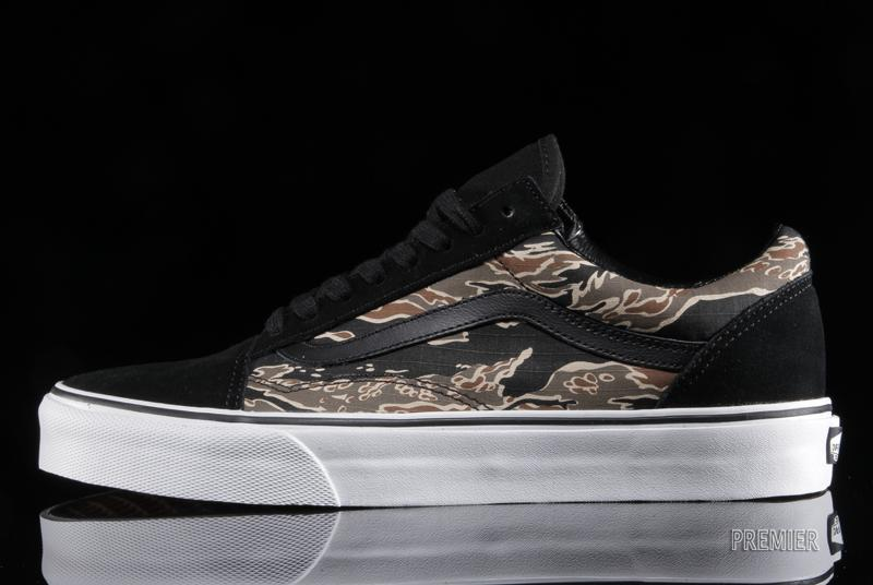 8f4348d490 ... Old Skool features a blend of heavy-duty tiger camo canvas and black  suede up top