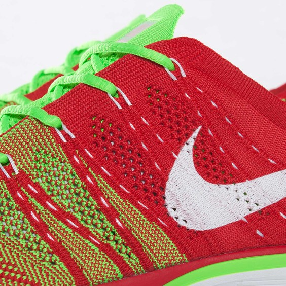 67cc38469bcce The Nike Flyknit Trainer+ in Red   Electric Green is available now at  select Nike accounts