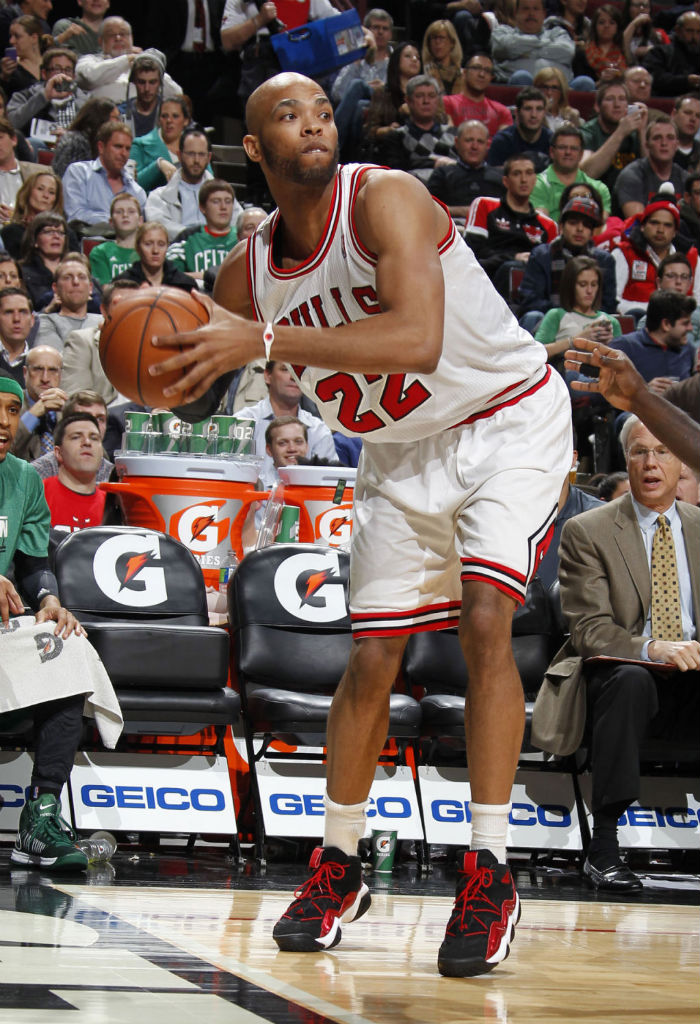 Taj Gibson wearing adidas Top Ten 2000 Black Red