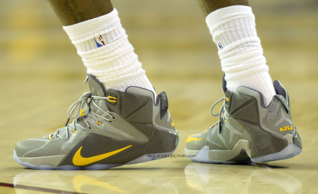 LeBron James wearing Nike LeBron XII 12 Grey/Yellow PE on December 2, 2014