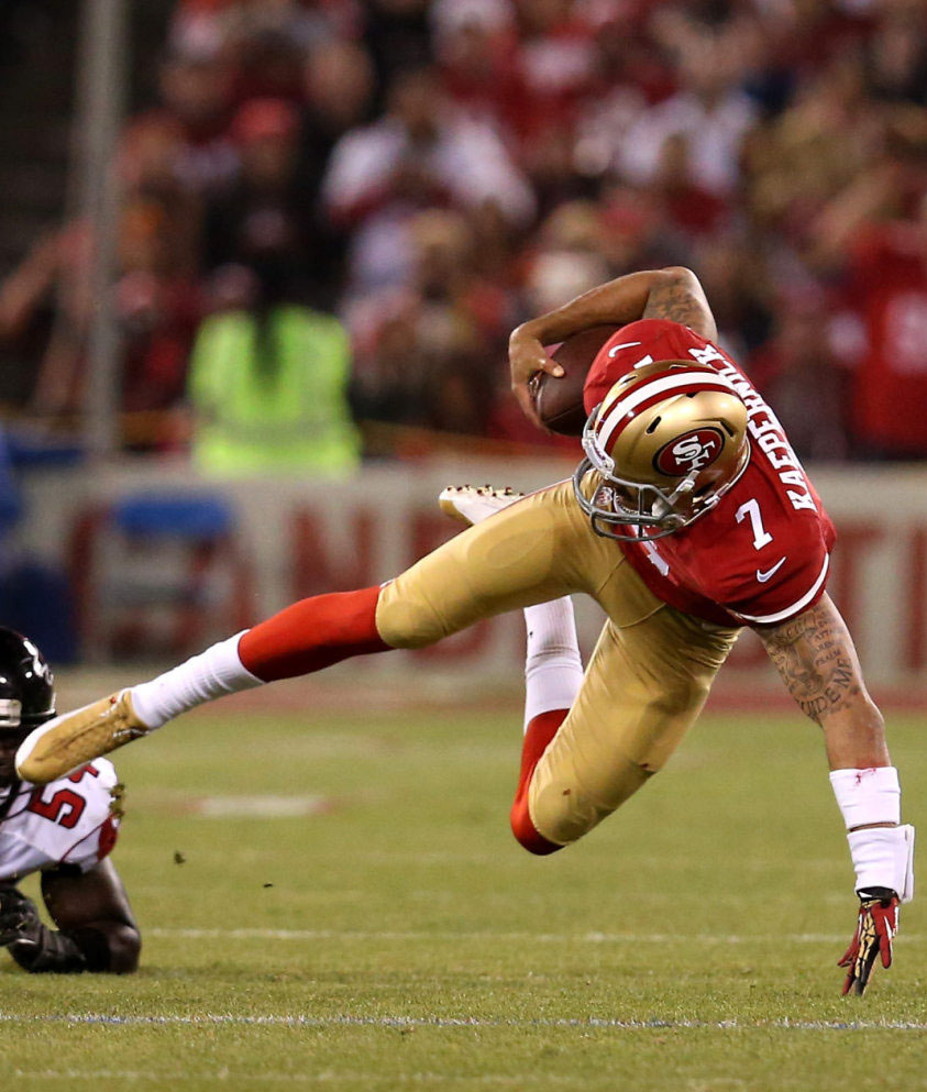 Colin Kaepernick wearing Air Jordan 12 PE Cleats (2)