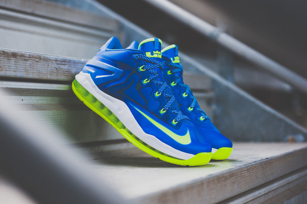 a072e21aab6e9 The  Sprite  Nike LeBron 11 Low hits nike.com and other Nike Sportswear  retailers such as Sneaker Politics on Saturday