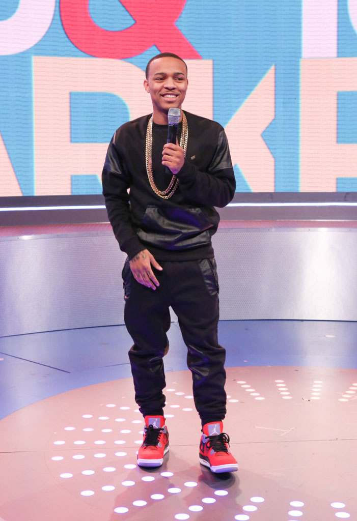 Bow Wow wearing Air Jordan 4 Retro Toro