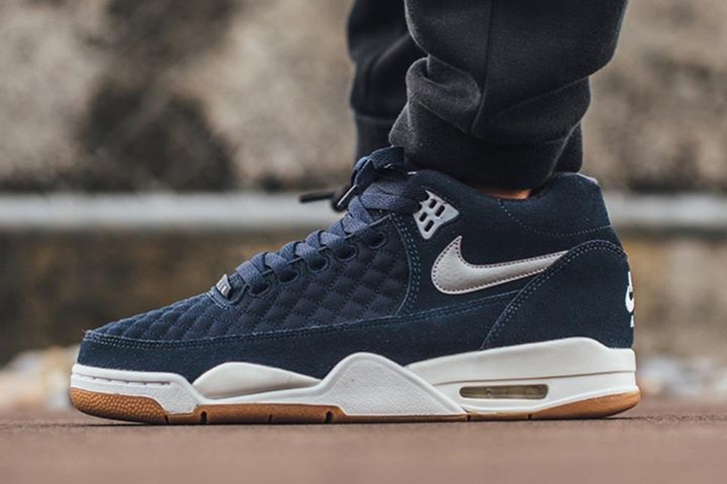 289ae03f7302 The Nike Flight Squad in obsidian gum is available now at select Nike  Sportswear retailers overseas such as Titolo.