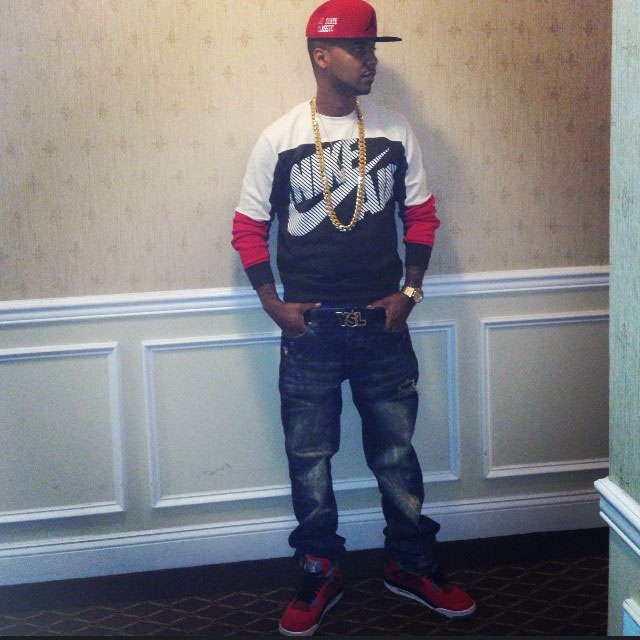 Juelz Santana wearing Air Jordan 4 Retro Toro