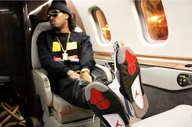 Future wearing Air Jordan IV 4 Cement