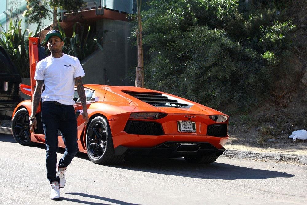 22293b20f32584 Chris Brown wearing Air Jordan V 5 CDP Fire Red (5)
