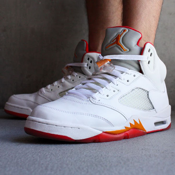 b83dcbb10be Shoe: Air Jordan 5 Retro Women's Colorway: White / Fire Red / Sunset /  Cinder Year: 2006. Biggest Size Made: 13