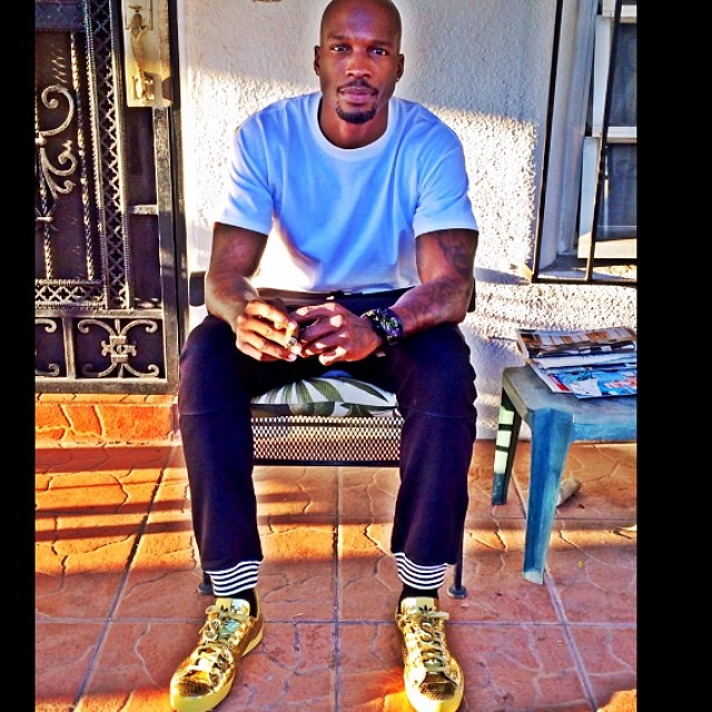 Chad Johnson wearing Jeremy Scott x adidas Originals Rod Laver
