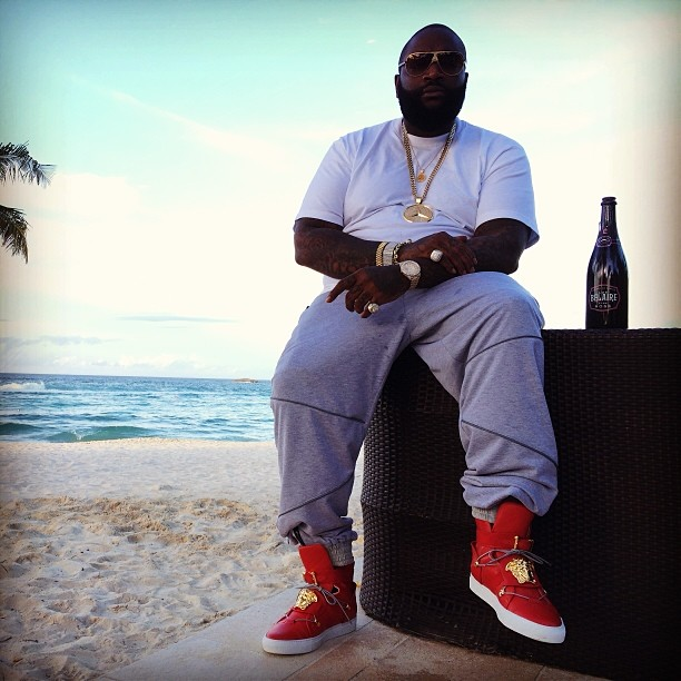 Rick Ross wearing Versace Medusa High-Top Sneakers