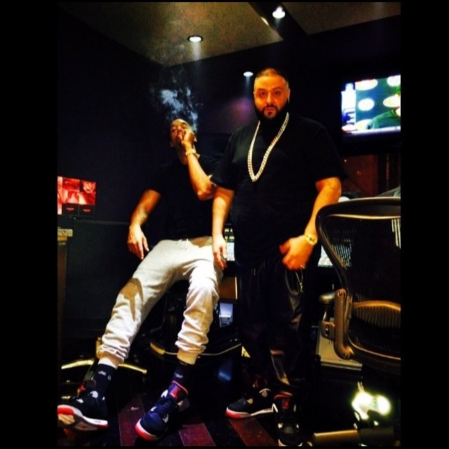 DJ Khaled wearing Air Jordan 4 Black/Cement