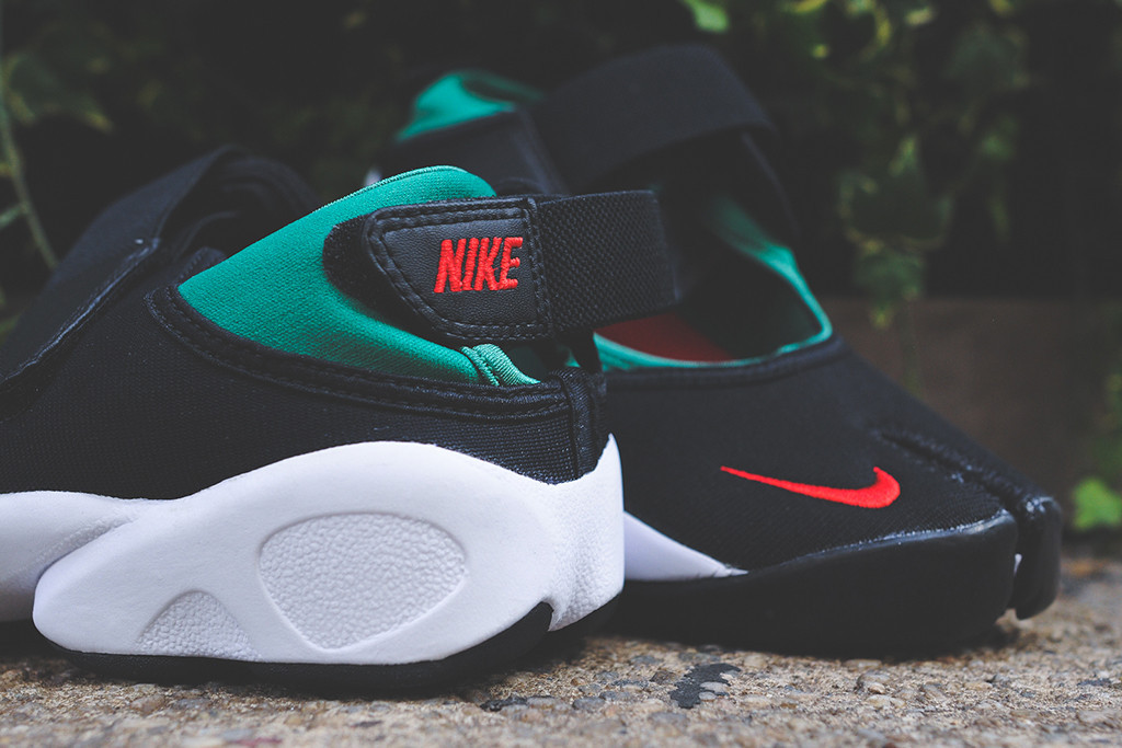 2fd05811d8e2bd The Air Rift in Black Forest Green Atomic Red is available at select Nike  Sportswear retailers like Kith NYC now in very limited quantities