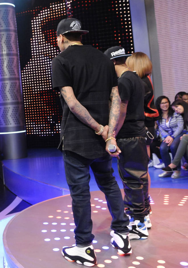 Bow Wow wearing Reebok Shaq Attaq; Chris Brown wearing Air Jordan XIII 13 White Black (3)