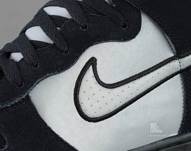 Nike Dunk High in black and reflective silver midfoot detail