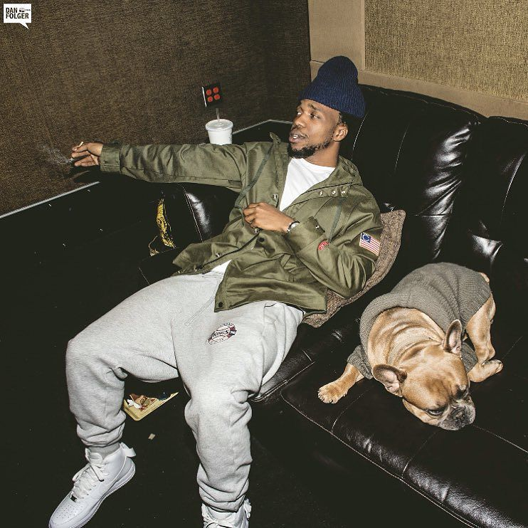 Currensy wearing the Nike Air Force 1 High