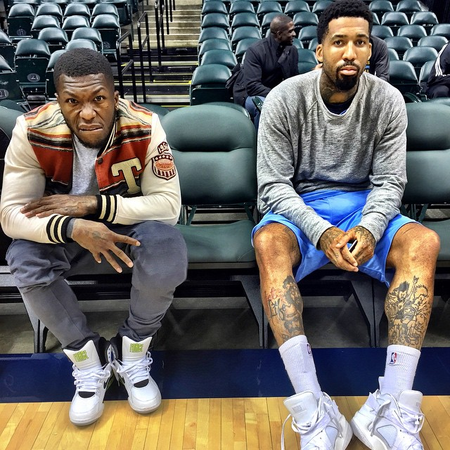 Nate Robinson wearing 'Billy Hoyle' Nike Air Command Force; Wilson Chandler wearing Pigalle x Nike Air Raid White