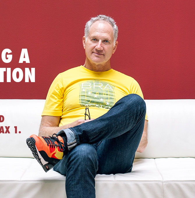 Tinker Hatfield wearing the 'Sunset' Nike Air Max 90 EM