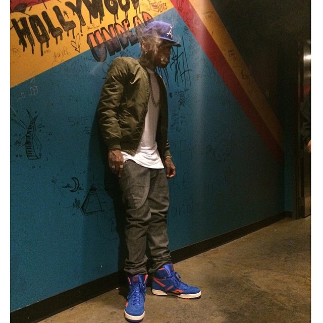 Kid Ink wearing Reebok BB4600