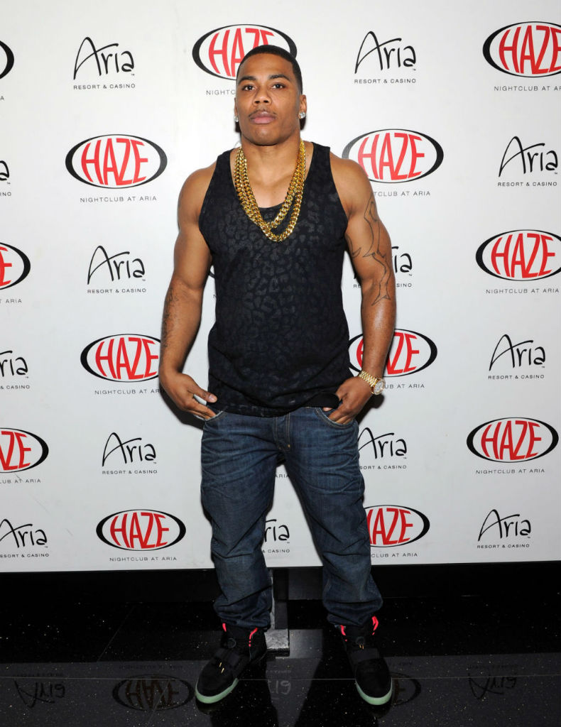 Nelly wearing Nike Air Yeezy 2 II Black Solar Red (1)