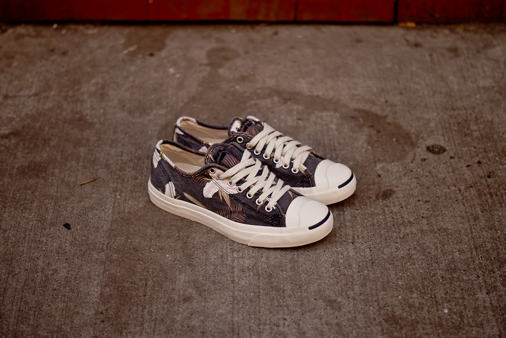 43777ec42b9820 ... Jack Purcell with its signature toe cap features a navy-based floral  canvas upper with a washed and faded effect. Look for them now at select  Converse ...