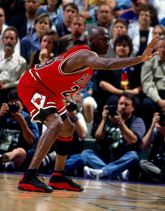 Michael Jordan wearing the 'Bred' Air Jordan 13