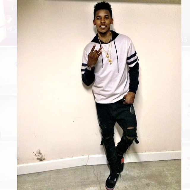 Nick Young wearing Air Jordan 4 Retro Black Cement