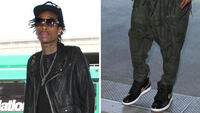Wiz Khalifa wearing Air Jordan Retro I 1 Black Gold