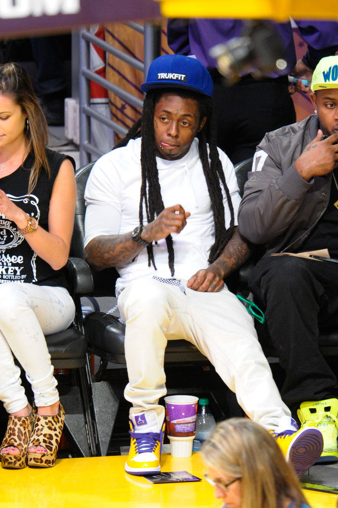Lil' Wayne wearing Air Jordan 1 Mid Lakers (1)