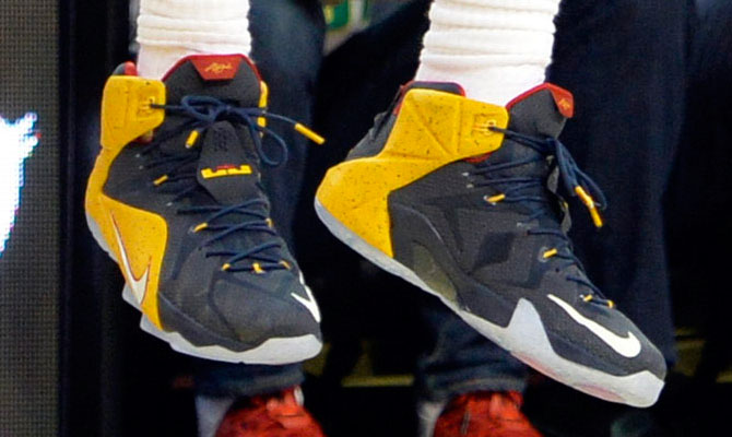 LeBron James wearing Blue/Yellow-Red Nike LeBron XII 12 PE on October 30, 2014