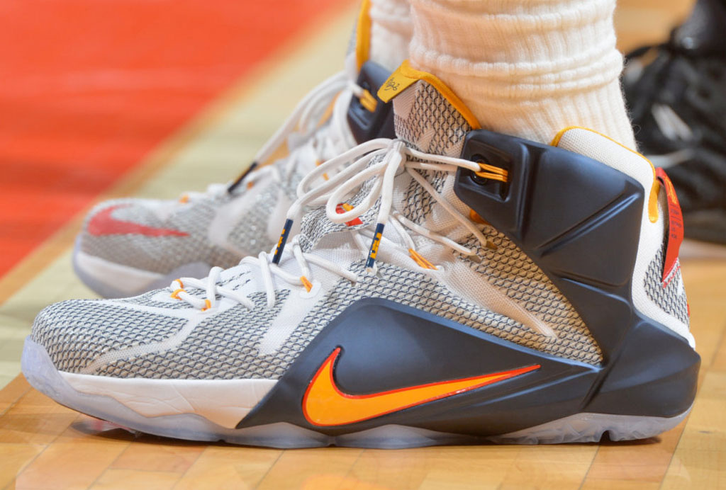 LeBron James wearing a White/Navy-Yellow-Red PE