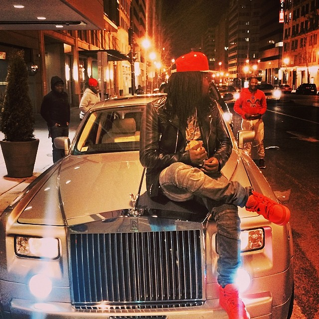 Wale wearing Nike Air Yeezy 2 Red October