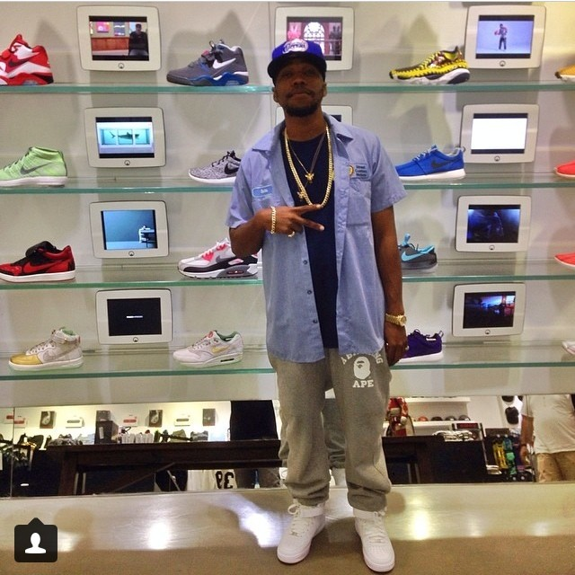 Currensy wearing Nike Air Force 1 Mid