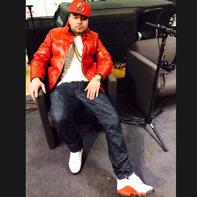 DJ Envy wearing Air Jordan 13 White/Red